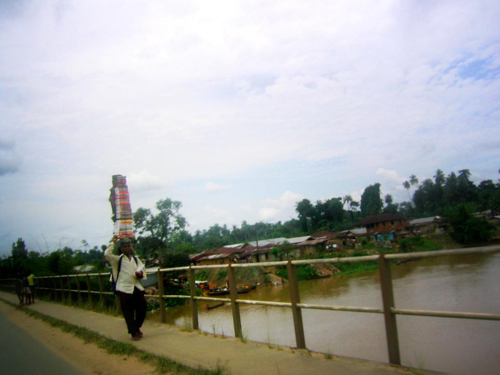 Book Salesman on bridge in Oloibiri., Baylesa State, Nigeria.