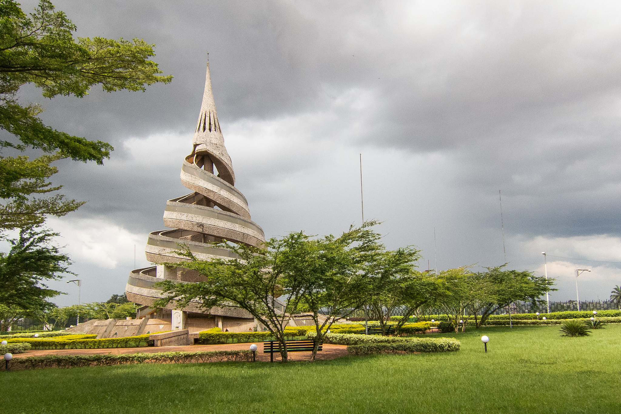 Reunification Monument - Yaoundé surrounded by grass and trees