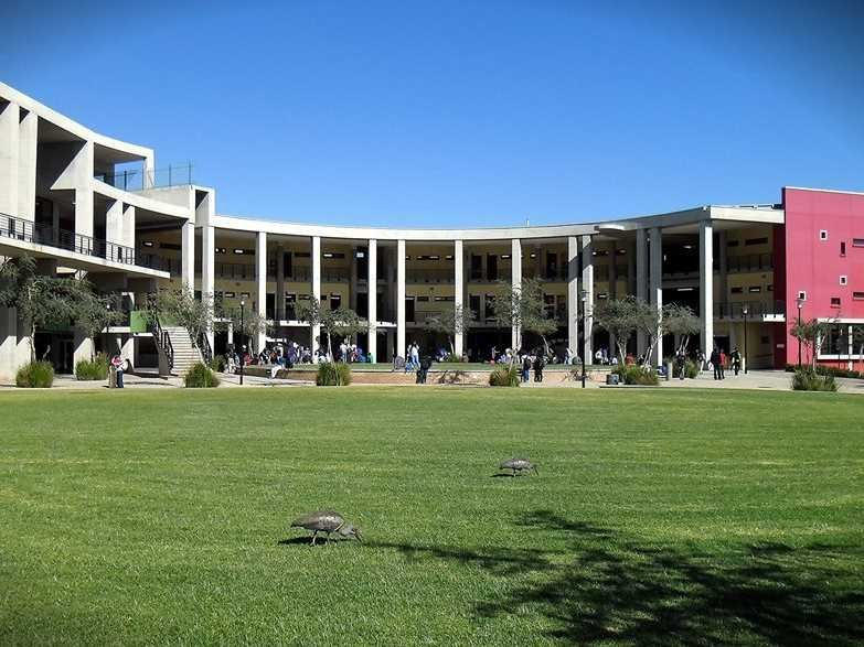 Photo of a university building at the University of the Witwatersrand with grass in front and blue sky above.