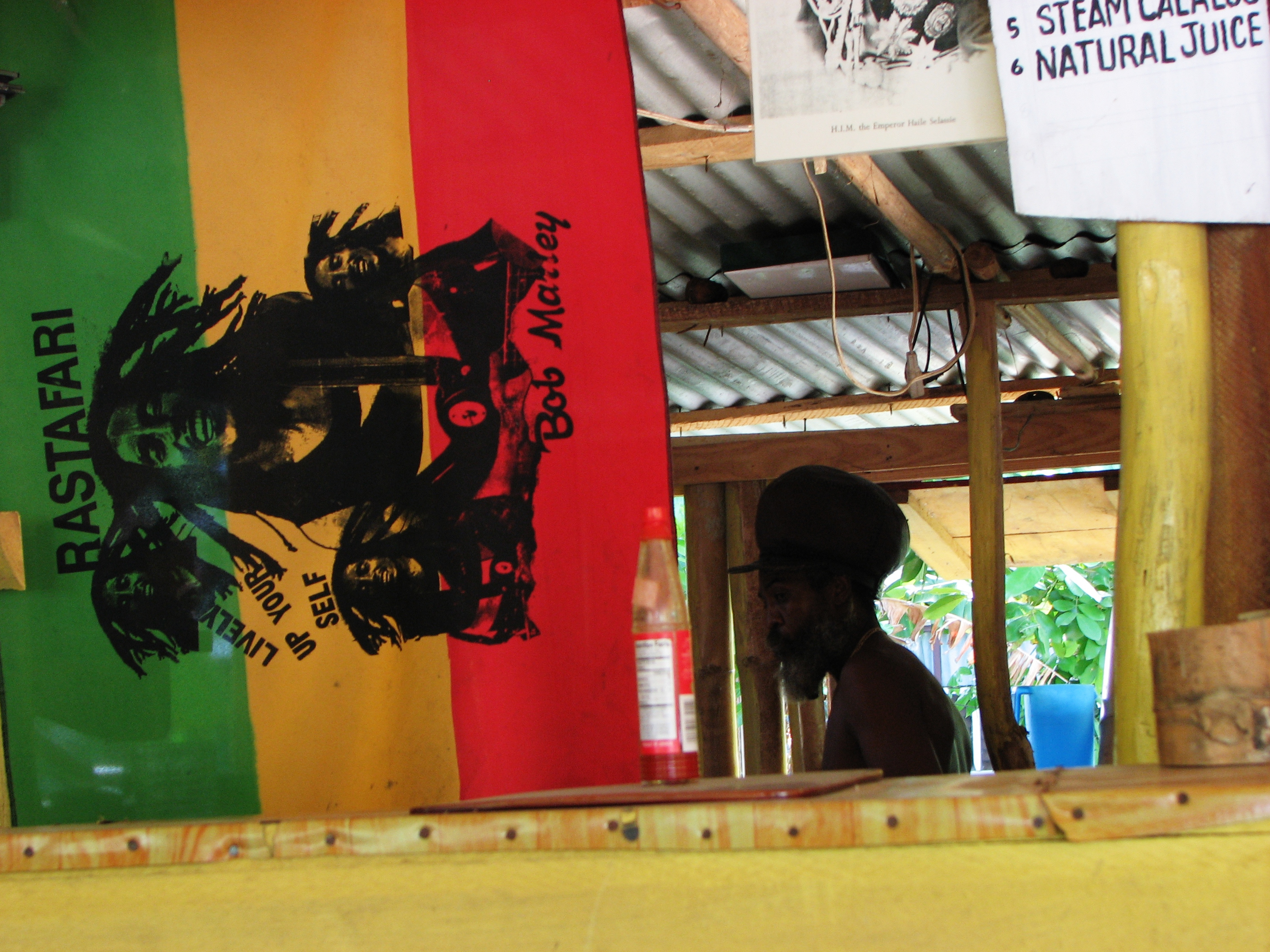 Rastafari Flag with a man standing in the background at a restaurant