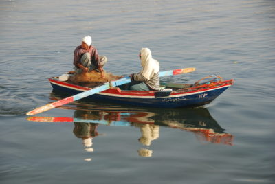 Two men in a boat on the River Nile