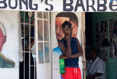 Outside township barbers, South Africa. Photo Credit David Rosen, via Flickr