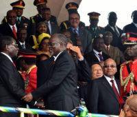 Newly inaugurated President John Pombe Magufuli greets President of Zimbabwe Robert Mugabe.