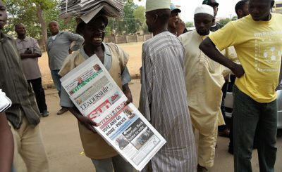 Newspaper vendor outside a polling station during the 2011 elections in Nigeria. Photo by Commonwealth Secretariat