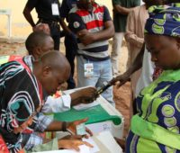 A voter getting accredited at the Area 1 FCT Abuja polling unit - photo by U.S. Embassy Nigeria / Idika Onyukwu